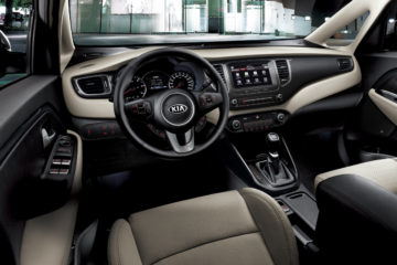 kia-carens-dashboard-side-view-beige-interior